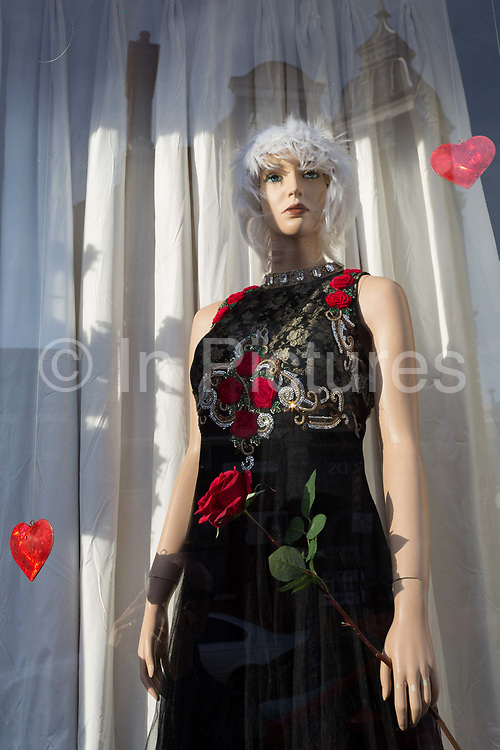 A female mannequin stands with a Valentines Day theme in the window of a local charity shop in East Dulwich, on 13th February 2019, in London, England.