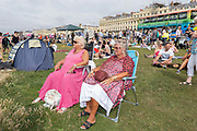 Two ladies sitting in Hove Gardens during the annual Brighton Pride parade on the 3rd August 2019 in Brighton in the United Kingdom.