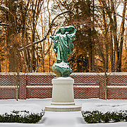 This statue of Christ The King is located at the Loyola Jesuit Center in Morristown, NJ.  It is the focal point of a beautiful and peaceful garden.  This shot was taken in the early morning with the first golden rays of light creating a beautiful background.