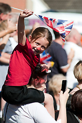 The Olympic Torch relay reaches Sheffield on day 38 coverage from the Chapeltown - Ecclesfield - Parson Cross section of the Journey.<br /> Young girl waves the union flag close to Cowley lane Junction with Welbourne Close Chapeltown<br /> 25 June 2012.Image © Paul David Drabble