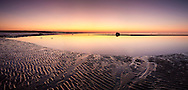 The afterglow of sunset lights the scene at Skaket Beach in Orleans.