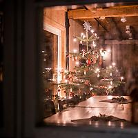 14 desember 2014. 10 dager til julaften. En regntung 3 søndag i advent. Et juletre kan sees gjennom vinduet på Søgne gamle prestegårds låvebygg som nå er kafe. Bjørnstjerne Bjørnson besøkte sin far her i perioder og er nå kultursenteret i Søgne.<br /> <br /> December 14 2014. 10 days til christmas eve in Søgne. A rainy sunday looking in to a christmas tree in the cafe in the old barn at Søgne old rectory. Famous norwegian writer Bjørnstjerne Bjørnson visited his father here and is now the culture senter in Søgne.