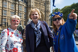 London, UK. 26 June, 2019. Anna Soubry, Change UK MP for Broxtowe, arrives to wish noted anti-Brexit campaigner Steve Bray of SODEM (Stand of Defiance European Movement) a happy 50th birthday outside Parliament.