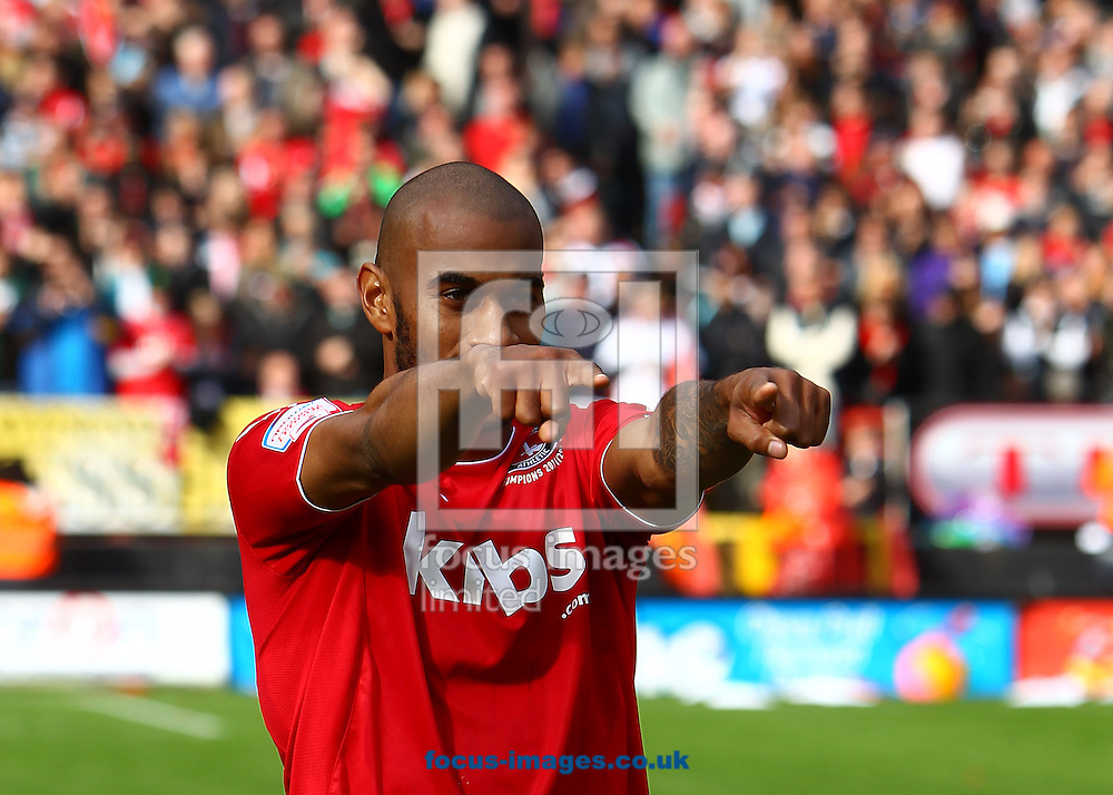 Picture by John Rainford/Focus Images Ltd. 07506 538356.05/05/12.Danny Haynes of Charlton Athletic goes up to collect his Npower League 1 winners medal at The Valley stadium, London.