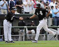 CHICAGO - JULY 18:  Jermaine Dye #23 is greeted by third base coach Jeff Cox #8 of the Chicago White Sox after hitting a two run home run against the Baltimore Orioles in the fifth inning on July 18, 2009 at U.S. Cellular Field in Chicago, Illinois.  The White Sox defeated the Orioles 4-3.  (Photo by Ron Vesely)