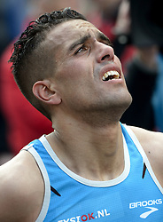 13-04-2014 NED: Marathon van Rotterdam<br /> Khalid Choukoud (midden) finished als beste Nederlander tijdens de marathon Rotterdam. De Haagse atleet eindigde in zijn debuut op de 42,195 kilometer als zevende in 2.10.51
