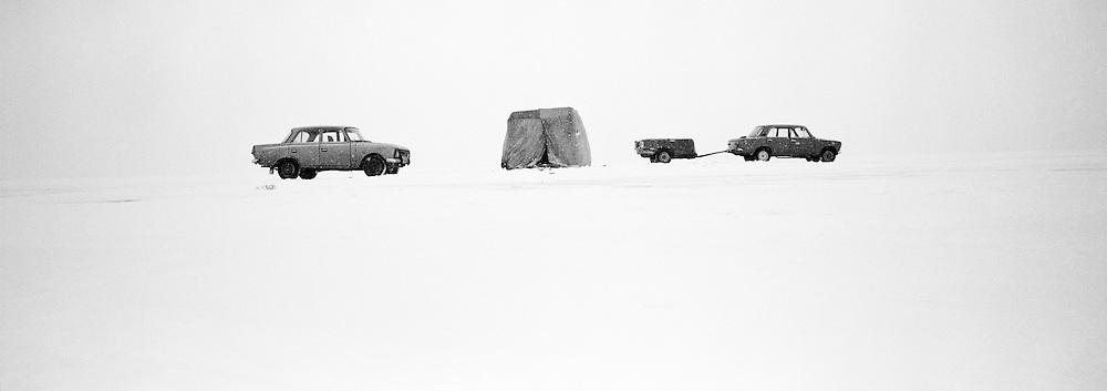 Fishermens tent and cars on the frozen Lake Baikal, Siberia, Rusia.