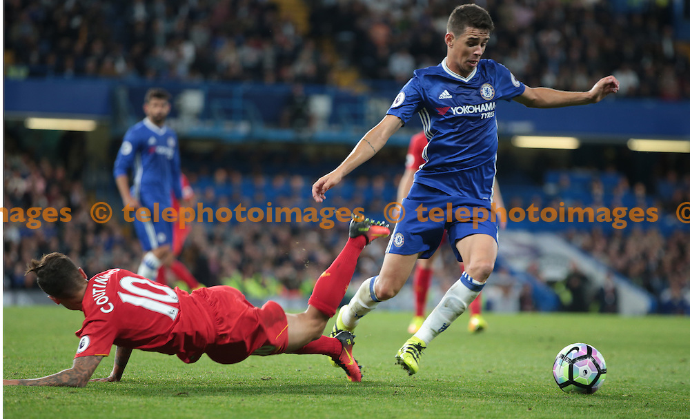 Chelsea's Oscar beats Liverpool's Philippe Coutinho<br /> during the Premier League match between Chelsea and Liverpool at Stamford Bridge in London. September 16, 2016.<br /> James Galvin / Telephoto Images<br /> +44 7967 642437