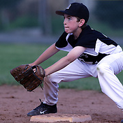 A young fielder at second base waits to make the play during the Norwalk Little League baseball competition at Broad River Fields, Norwalk, Connecticut. USA. Photo Tim Clayton