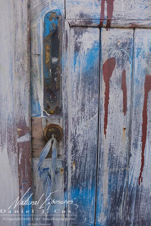Paints cover an old door, Havana, Cuba