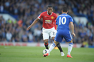 Antonio Valencia of Manchester United looks to go past Eden Hazard of Chelsea.Barclays Premier league match, Chelsea v Manchester Utd at Stamford Bridge Stadium in London on Saturday 18th April 2015.<br /> pic by John Patrick Fletcher, Andrew Orchard sports photography.