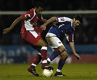 Photo: Jonathan Butler.<br />Swindon Town v Carlisle United. The FA Cup. 11/11/2006.<br />Jerel Ifil of Swindon competes for the ball with Derek Holmes of Carlisle.
