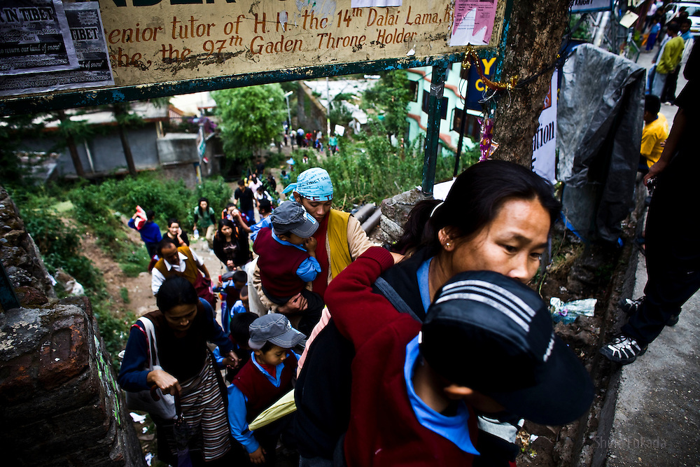INDIA - Life in Exile (Tibetan Refugees) <br /> Tibetan parents pick up kids from school in McLeod Ganj, Dharamsala, India, where the Dalai Lama settled after fleeing Tibet in 1959 after a failed uprising against Chinese rule, May 30, 2009.