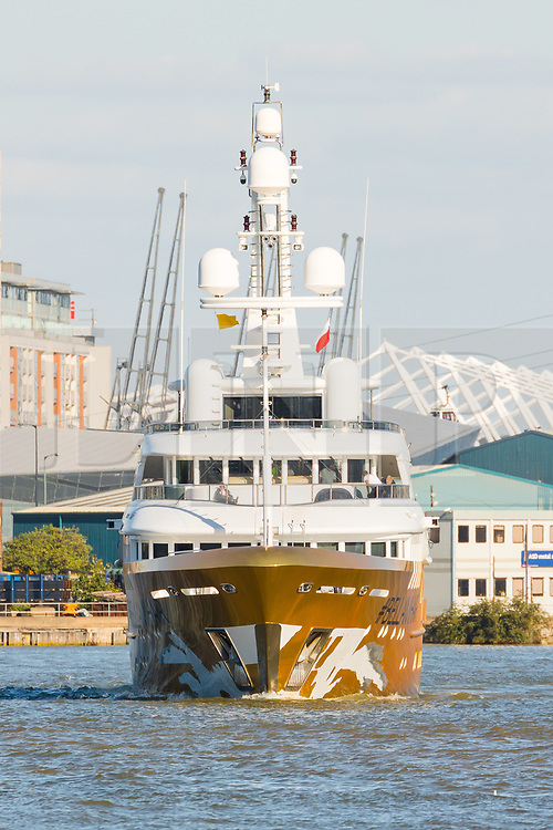 © Licensed to London News Pictures. 17/09/2019. London, UK. Gold wrapped, 175 feet long superyacht, Bellami.com arrives in London on the River Thames before mooring in East India Dock. It took 13 days and 600sqm of gold chrome vinyl wrap to cover the superyacht formally known as 'Kinta' at the Port of Viareggio in Italy this year and is the largest chrome yacht wrap done fully in the water and possibly the largest chrome wrap ever. As Bellami.com arrived, it was noticed that some of the chrome wrap was already damaged and missing. Photo credit: Vickie Flores/LNP