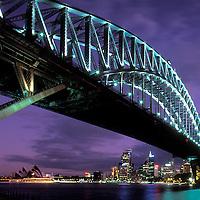 Australia, New South Wales, The Sydney Harbour Bridge fills the twilight sky over Sydney downtown skyline
