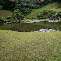 """Kannon-in Garden was built in the mid 17th century and artfully incorporates the forest behind the pond as its natural background.  This style is called Shakkei """"borrowed scenery"""".  Kannon-in Garden was designated as a national scenic spot by the Japanese government."""