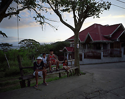Residents hang out in the so-called Italian Village of Pulong Anahao, Batangas, Philippines on Dec. 2006.  It is common to see many men around the Italian-style villas and raising the children in this area, while the women are working abroad.