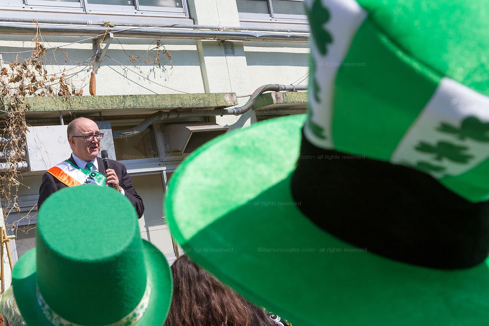 """The Irish Ambassador, Paul Kavanagh talks before the 27th Saint .Patrick's Day Parade in Omotesando, Tokyo, Japan. Sunday March 17th 2019. Started in 1992 by the Irish Network, Japan, and supported by the Embassy of Ireland,; the parade, along with the """"I Love Ireland Festival"""" held nearby is Asia's  largest Irish event."""