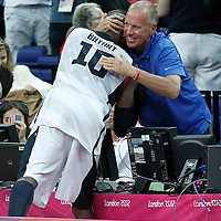 12 August 2012: USA Kobe Bryant is congratulated by Doug Collins after the 107-100 Team USA victory over Team Spain, during the men's Gold Medal Game, at the North Greenwich Arena, in London, Great Britain.