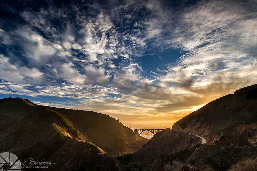 Setting sun at Bixby Bridge, Highway 1, on the California Big Sur Coast, South of Carmel