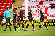 Referee Ben Toner shows Barnsley forward Jacob Brown (33) the yellow card for taking his shirt off after scoring the winning goal in time added on during the EFL Sky Bet League 1 match between Walsall and Barnsley at the Banks's Stadium, Walsall, England on 23 March 2019.