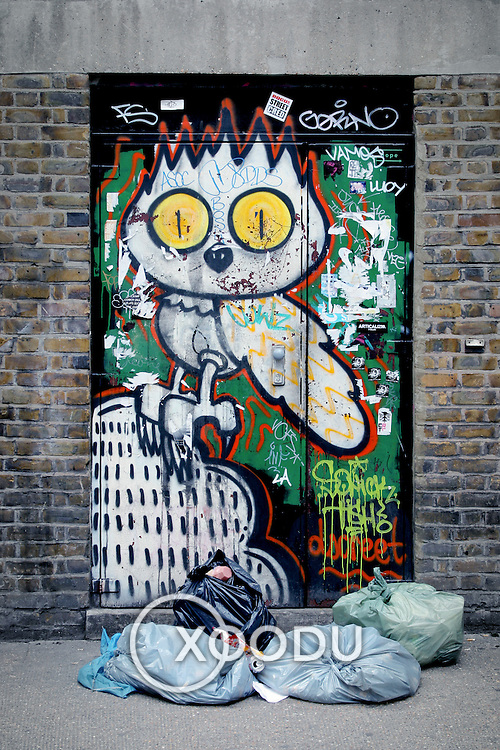 Graffiti door owl rubbish, London, England (July 2007)