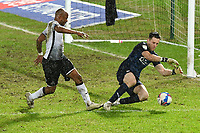 Football - 2020 / 2021 Sky Bet Championship - Swansea City vs Barnsley - Liberty Stadium<br /> <br /> Jack Walton of Barnsley  defends  André Ayew of Swansea on the attack<br /> COLORSPORT/WINSTON BYNORTH