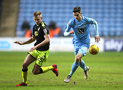 Coventry City's Tom Bayliss (right) and Cambridge United's Harry Darling battle for the ball