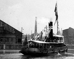 "© Licensed to London News Pictures. 30/09/2016. Birkenhead UK. Collect picture shows the Ralph Brocklebank (Daniel Adamson) in Manchester for the visit of King Fuad (date unknown). The Daniel Adamson steam boat has been bought back to operational service after a £5M restoration. The coal fired steam tug is the last surviving steam powered tug built on the Mersey and is believed to be the oldest operational Mersey built ship in the world. The ""Danny"" (originally named the Ralph Brocklebank) was built at Camel Laird ship yard in Birkenhead & launched in 1903. She worked the canal's & carried passengers across the Mersey & during WW1 had a stint working for the Royal Navy in Liverpool. The ""Danny"" was refitted in the 30's in an art deco style. Withdrawn from service in 1984 by 2014 she was due for scrapping until Mersey tug skipper Dan Cross bought her for £1 and the campaign to save her was underway. Photo credit: Andrew McCaren/LNP"