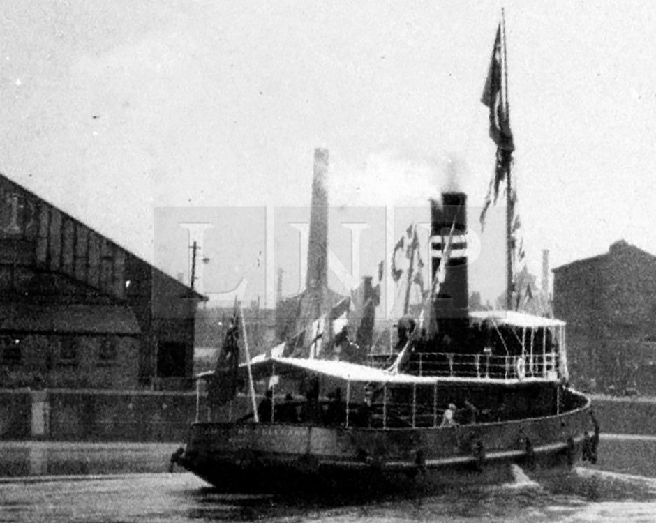 """© Licensed to London News Pictures. 30/09/2016. Birkenhead UK. Collect picture shows the Ralph Brocklebank (Daniel Adamson) in Manchester for the visit of King Fuad (date unknown). The Daniel Adamson steam boat has been bought back to operational service after a £5M restoration. The coal fired steam tug is the last surviving steam powered tug built on the Mersey and is believed to be the oldest operational Mersey built ship in the world. The """"Danny"""" (originally named the Ralph Brocklebank) was built at Camel Laird ship yard in Birkenhead & launched in 1903. She worked the canal's & carried passengers across the Mersey & during WW1 had a stint working for the Royal Navy in Liverpool. The """"Danny"""" was refitted in the 30's in an art deco style. Withdrawn from service in 1984 by 2014 she was due for scrapping until Mersey tug skipper Dan Cross bought her for £1 and the campaign to save her was underway. Photo credit: Andrew McCaren/LNP"""