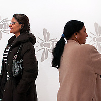 """011114       Cable Hoover<br /> <br /> Patricia Kumar, left, and Kanta Patel check out an installation called """"Collapse"""" by Gallup artist Michael Gambill inside Art123 Gallery during ArtsCrawl in downtown Gallup Saturday."""
