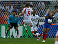 Photo: Glyn Thomas.<br />France v Switzerland. Group G, FIFA World Cup 2006. 13/06/2006.<br /> France's Thierry Henry (R) takes evasive action from a shot from Switzerland's Johann Vogel.