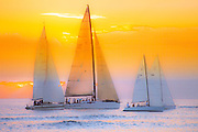 Sailboats against the sunset sky
