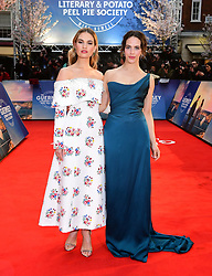 Lily James (left) and Jessica Brown Findlay attending The Guernsey Literary and Potato Peel Pie Society world premiere held at Curzon Mayfair, London.
