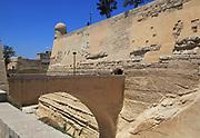 Bridge crossing moat to fortified city walls, Saint James bastion, Valletta, Malta