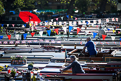 © Licensed to London News Pictures. 05/05/2018. London, UK. Bit owners stand on top of the boats in the early morning sun as the Canalway Cavalcade festival takes place in Little Venice, West London on Saturday,  May 5th 2018. Inland Waterways Association's annual gathering of canal boats brings around 130 decorated boats together in Little Venice's canals on May bank holiday weekend. Photo credit: Ben Cawthra/LNP