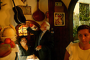 """Argentina Santos waiting at the Fado house """"Parreirinha de Alfama"""". Argentina Santos is well know for her peculiar deep voice and is one of the most respected Fado singers from her generation."""
