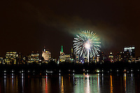 Fireworks over the Jacqueline Kennedy Onassis Reservoir in New York's Central Park after the New York Philharmonic played for a packed crowd in the Great Lawn. .. Photo by Robert Caplin