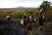 Women take a rest on a hilltop after walking for several kilometres to a traditional initiation ceremony into adulthood of men aged between 18 and 20 in a Pokot community of herdsmen in Baringo County, Kenya, October 1, 2018.