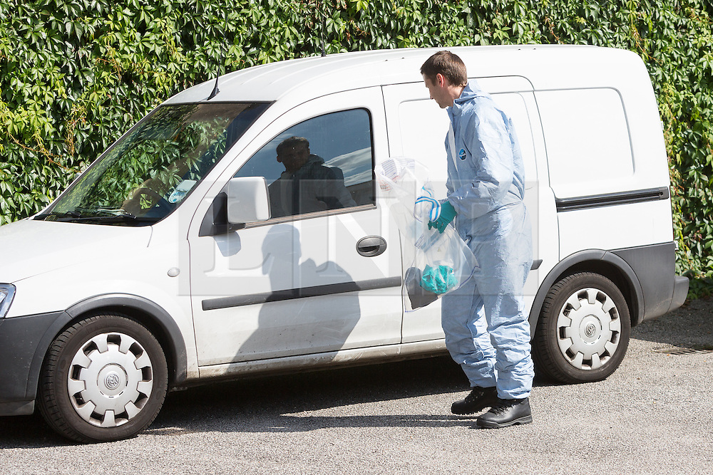 © Licensed to London News Pictures. 06/09/2015. London, UK. A forensic officer outside Fernways sheltered housing unit in Fernways off Cecil Road in Ilford, Essex. Police attended the unit last night following reports of an assault. A woman aged in her mid-50's and a man in his mid-80's were pronounced dead at the scene last night, who suffered stabbing injuries. Photo credit : Vickie Flores/LNP