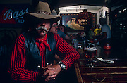 Cowboy Rich Gray enjoys a cigar in the Copper Queen bar, Bisbee, Arizona..Subject photograph(s) are copyright Edward McCain. All rights are reserved except those specifically granted by Edward McCain in writing prior to publication...McCain Photography.211 S 4th Avenue.Tucson, AZ 85701-2103.(520) 623-1998.mobile: (520) 990-0999.fax: (520) 623-1190.http://www.mccainphoto.com.edward@mccainphoto.com