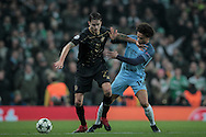 Mikael Lustig (Celtic) and Leroy Sané (Manchester City) battle for the ball during the Champions League match between Manchester City and Celtic at the Etihad Stadium, Manchester, England on 6 December 2016. Photo by Mark P Doherty.