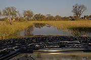 Tourist Game Vehicle traversing flood waters<br /> Moremi Game Reserve, Okavango Delta<br /> BOTSWANA
