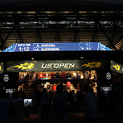 2016 U.S. Open - Day 6   Arthur Ashe Stadium at dusk with  a shop selling UP Open apparel in the foreground at the 2016 US Open Tennis Tournament at the USTA Billie Jean King National Tennis Center on September 3, 2016 in Flushing, Queens, New York City.  (Photo by Tim Clayton/Corbis via Getty Images)