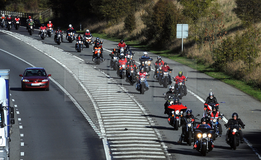 © Licensed to London News Pictures. 10/11/2013<br /> Ring of Red bikers M25 Junction 3  Swanley clockwise.<br /> Thousands of Bikers ride a Ring of Red on the M25 today (10.11.2013) for  Remembrance sunday.<br /> Photo credit :Grant Falvey/LNP