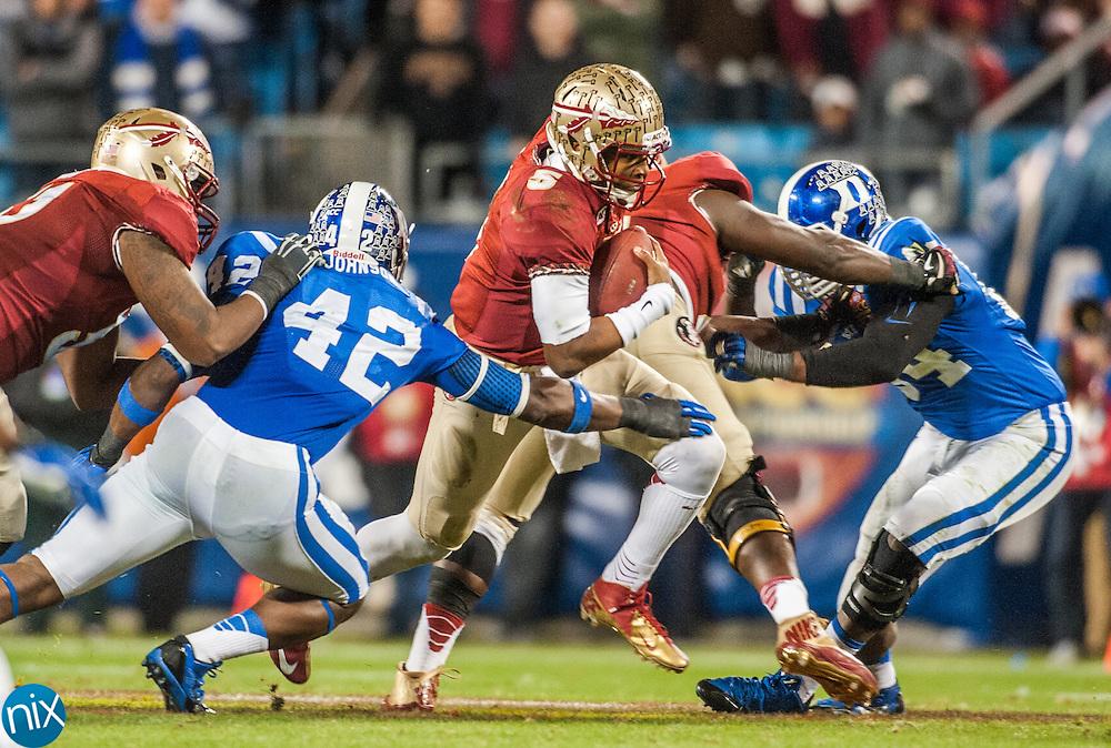 Florida State quarterback Jameis Winston scrambles against Duke during the ACC Championship game at Bank of America Stadium in Charlotte Saturday night. Florida State won the game 45-7.