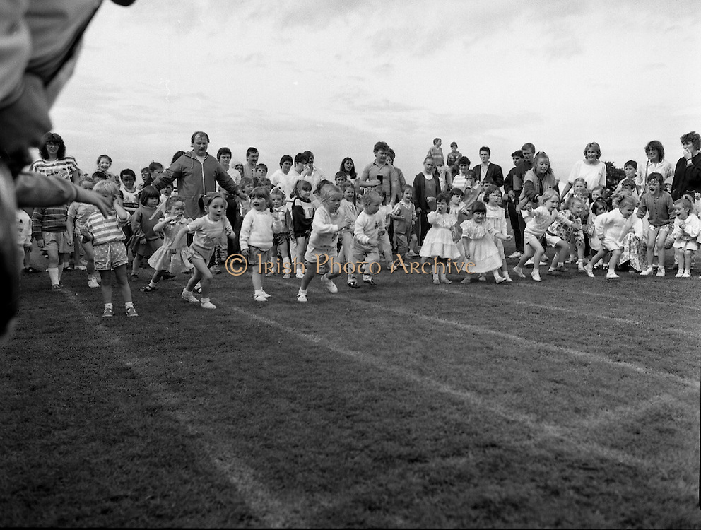 """Guinness Family Day At The Iveagh Gardens. (R83)..1988..02.07.1988..07.02.1988..2nd  July 1988..The family fun day for Guinness employees and their families took place at the Iveagh Gardens today. Top at the bill at the event were """"The Dubliners"""" who treated the crowd to a performance of all their hits. Ireland's penalty hero from Euro 88, Packie Bonner, was on hand to sign autographs for the fans...Ready, Steady, Go! the children are pictured starting the race."""