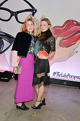 Left to right, PAULA GOLDSTEIN and AMBER ATHERTON at the launch of The Lulu Perspective to celebrate 25 years of Lulu Guinness held at 74a Newman Street, London on 13th September 2014.