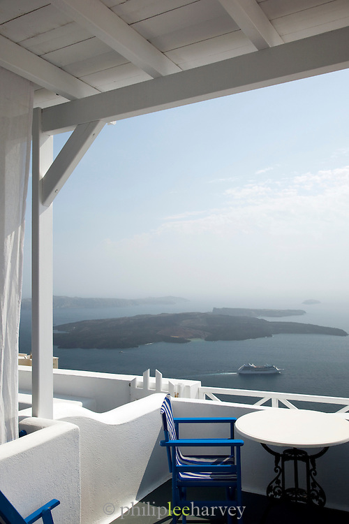 Terrace balcony overlooking a bay in Imerovigli, balcony to the Aegean, an area in Fira village, Santorini, Greece