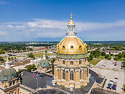Aerial photograph of the beautiful and ornate gold-leaf covered dome of the Iowa State Capitol building; Des Moines, Iowa, USA.